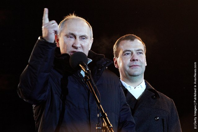 Russian Prime Minister and presidential candidate Vladimir Putin speaks as current President Dmitry Medvedev (R) listens during a rally after Putin claimed victory in the presidential election at the Manezhnya Square March, 4, 2012 in Moscow, Russia