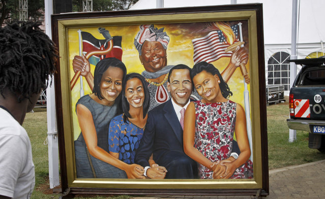 A painting depicting the Obama family and step-grandmother Sarah Obama above, stands outside an exhibition about the Global Entrepreneurship Summit which President Barack Obama will attend later in the week, in Nairobi, Kenya Wednesday, July 22, 2015. In his first trip to Kenya since he was a U.S. senator in 2006, Obama is scheduled to arrive in Kenya on Friday, the first stop on his two-nation African tour in which he will also visit Ethiopia. (Photo by Khalil Senosi/AP Photo)
