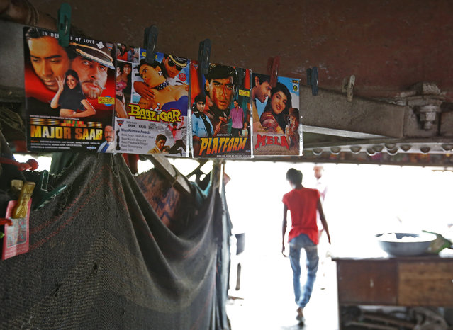 Films that are being screened are advertised in a makeshift cinema located under a bridge in the old quarters of Delhi, India May 25, 2016. (Photo by Cathal McNaughton/Reuters)