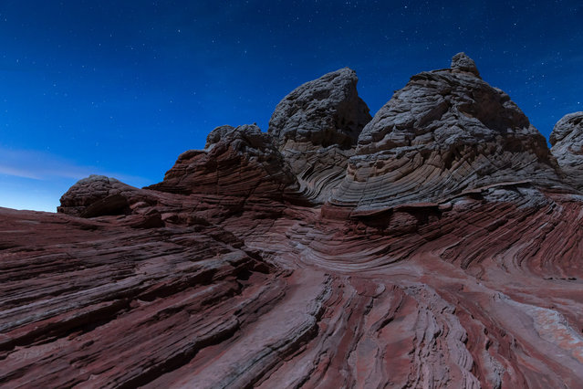 A moonlit photograph of rock formations at White Pocket, Arizona. (Photo by David Clapp/Barcroft Images)