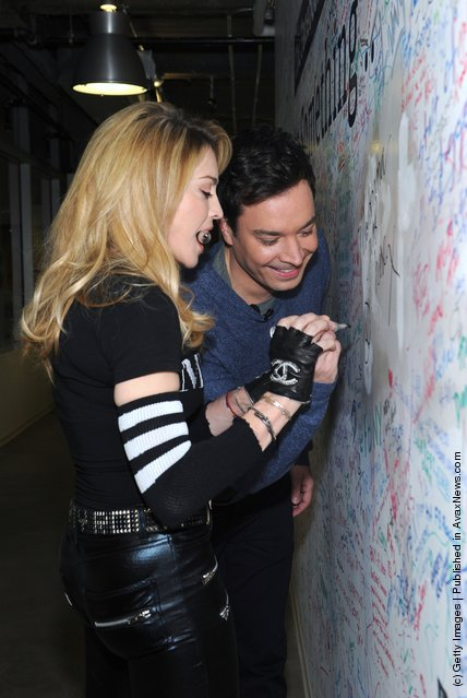 Jimmy Fallon and Madonna sign the Facebook wall before their livestream interview at the Facebook offices