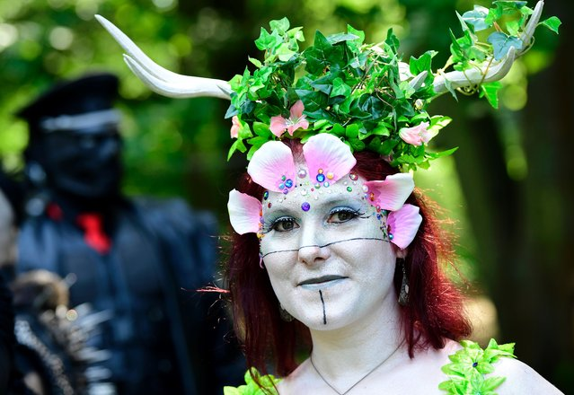"A dressed up woman attends a so-called ""Victorian Picnic"" during the Wave-Gotik-Treffen (WGT) festival in Leipzig, eastern Germany, on June 2, 2017. (Photo by Tobias Schwarz/AFP Photo)"