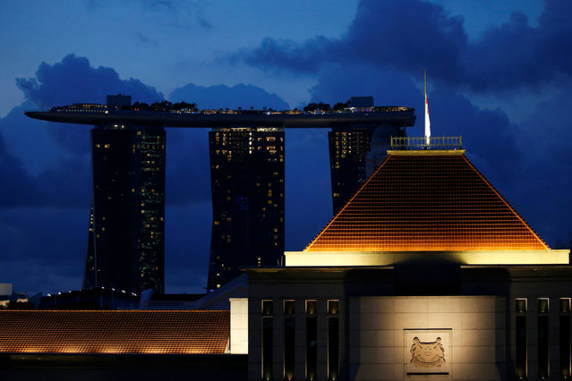Singapore's national flag hangs at half mast to mourn the passing of former president S.R. Nathan at the parliament house in Singapore August 23, 2016. (Photo by Edgar Su/Reuters)