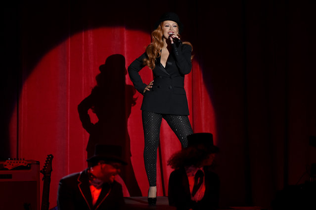 "Singer Christina Aguilera performs onstage during the ""Hillary Clinton: She's With Us"" concert at The Greek Theatre on June 6, 2016 in Los Angeles, California. (Photo by Kevin Winter/Getty Images)"