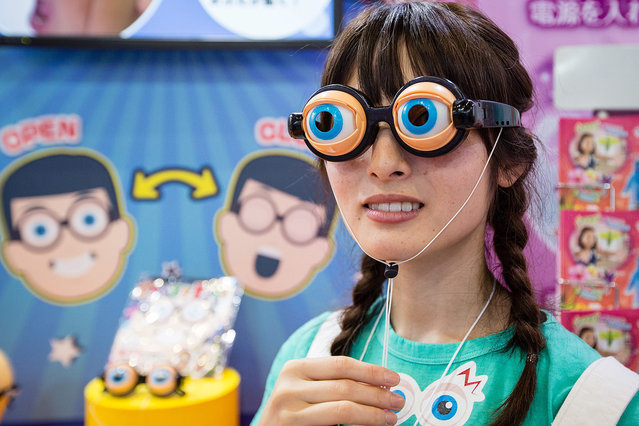 A campaign model demonstrates crazy eyes glasses during the International Tokyo Toy Show 2016 in Tokyo, Japan, 09 June 2016. The trade show opens to the general public on 11 and 12 June. (Photo by Christopher Jue/EPA)