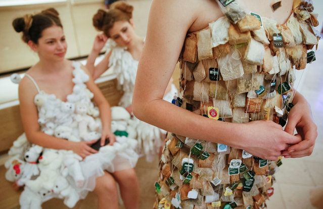 Models rest backstage after a runway show by French eco-designer Isagus Toche,  as a part of ecological forum, in Kiev, Ukraine, June 23, 2017. (Photo by Valentyn Ogirenko/Reuters)