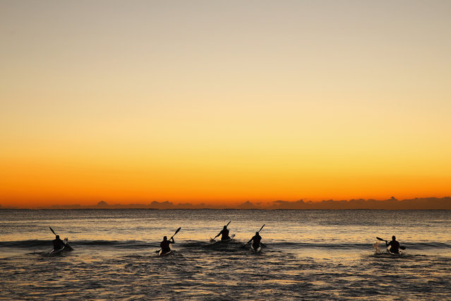 Ocean paddlers train on surf ski's at Manly Beach on July 28, 2015 in Sydney, Australia. (Photo by Cameron Spencer/Getty Images)