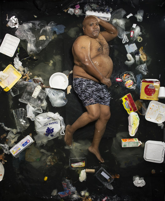 James surrounded by seven days of his own rubbish in Pasadena, California. egal is an unforgettable reminder of the amount of waste a human collects in just seven days. (Photo by Gregg Segal/Barcroft Media)