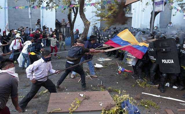 Demonstrators clash with police during a march in Quito, Ecuador, August 13, 2015. (Photo by Guillermo Granja/Reuters)