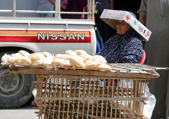 A street vendor sells bread at a street corner in central Cairo, Egypt May 25, 2016. (Photo by Amr Abdallah Dalsh/Reuters)