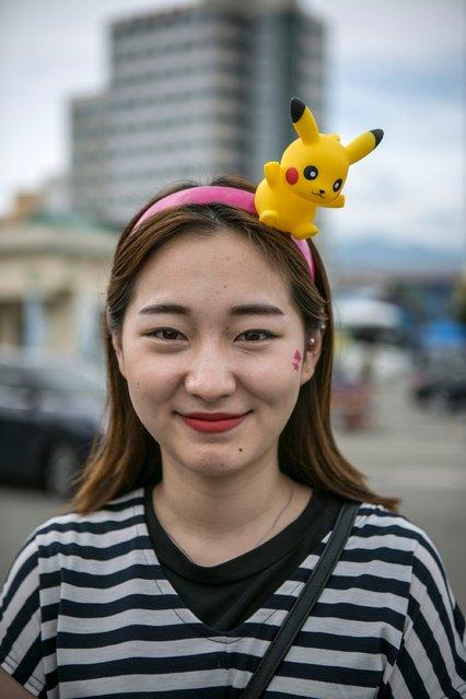 Barbie Lim, Broadcasting Jockey for a Pokeon Go Korea Facebook, wears a Pikachu headpiece on July 15, 2016 in Sokcho, South Korea. (Photo by Jean Chung/Getty Images)