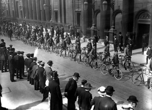 Automobile Association bicycle scouts in procession on their way to Liverpool Street  Station, en route to camp, September 1914.