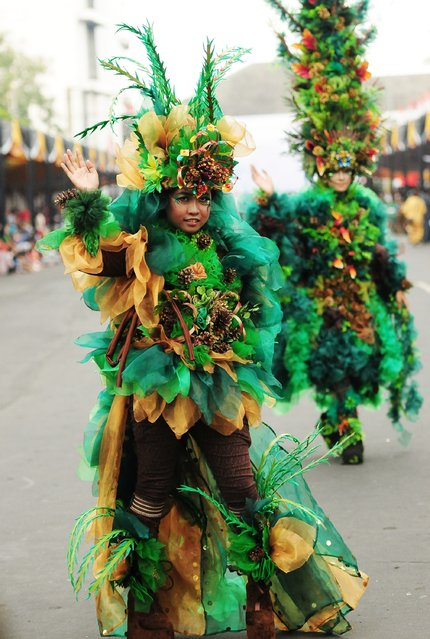 A model wears a Pine Forest costume in the kids carnival during The 13th Jember Fashion Carnival 2014 on August 21, 2014 in Jember, Indonesia. (Photo by Robertus Pudyanto/Getty Images)