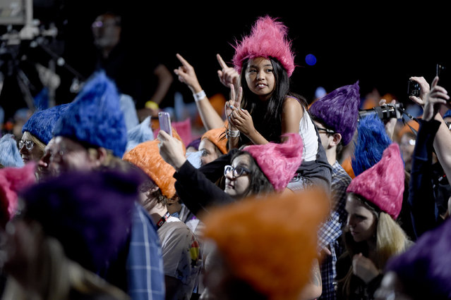 """A fan wearing a Troll wig poses for a photo at the """"Trolls"""" panel on day 1 of Comic-Con International on Thursday, July 21, 2016, in San Diego. (Photo by Chris Pizzello/Invision/AP Photo)"""