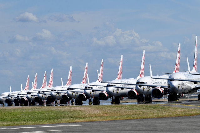 Grounded Virgin Australia aircraft are seen parked at Brisbane Airport in Brisbane, Tuesday, April 7, 2020. Brisbane Airport Corporation (BAC) is working with airlines by accommodating up to 100 grounded aircraft free of charge in response to government-mandated travel restrictions that have grounded a significant proportion of Australia's airline fleet because of the Coronavirus (COVID-19). (Photo by Darren England/AAP Image)