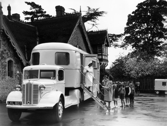 Children at Aylesford entering a mobile dentist and clinic, built for the Kent County Council's school health service for use in areas where village halls and other public buildings are unsuitable. 27th April 1949 (Photo by Topical Press Agency)