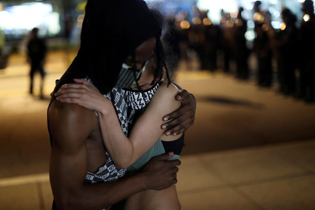 Demonstrators embrace during a protest against the death in Minneapolis police custody of George Floyd, near the White House, in Washington, U.S., May 30, 2020. (Photo by Jonathan Ernst/Reuters)