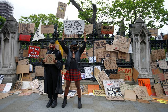 Demonstrators hold up signs in Parliament Square during a Black Lives Matter protest in London, following the death of George Floyd who died in police custody in Minneapolis, London, Britain, June 7, 2020. (Photo by Peter Nicholls/Reuters)