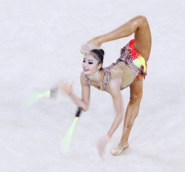 Kaho Minagawa of Japan performs with the clubs during the Individual All-Around Qualification at the Rhythmic Gymnastics event of the Rio 2016 Olympic Games at the Rio Olympic Arena in Barra da Tijuca, Rio de Janeiro, Brazil, 19 August 2016. (Photo by How Hwee Young/EPA)