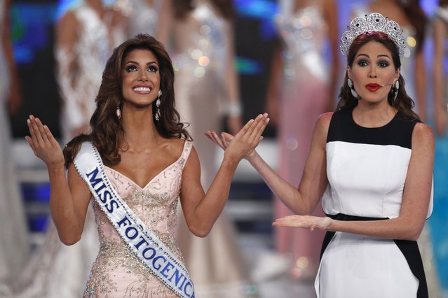 Miss Guarico, Mariana Jimenez, (L) reacts next to Miss Universe 2013, Maria Gabriela Isler, after winning the Miss Venezuela 2014 pageant in Caracas October 9, 2014. (Photo by Carlos Garcia Rawlins/Reuters)