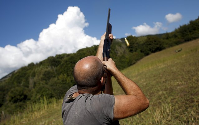 An hunter shoots during the first day of the Italy hunting season in Castell'Azzara, Tuscany, central Italy, September 20, 2015. (Photo by Max Rossi/Reuters)