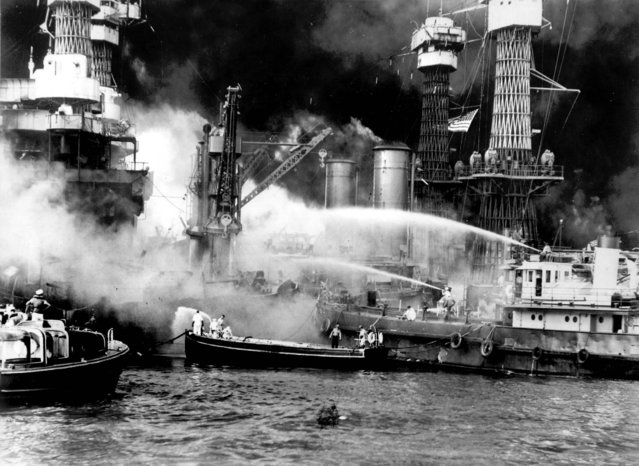 The battleship USS West Virginia is seen afire after the Japanese surprise attack on Pearl Harbor.  (Photo by Associated Press)