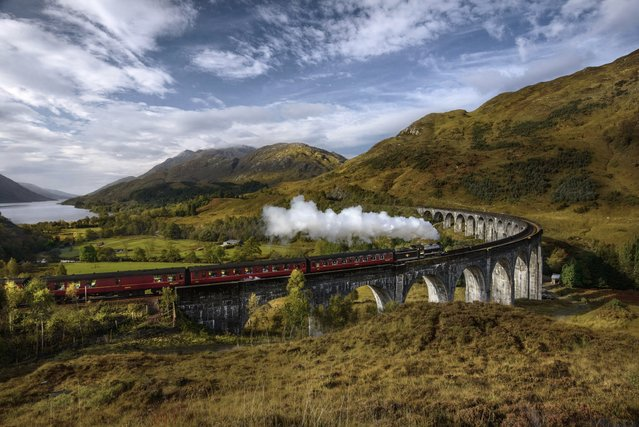 """Glenfinnan Viaduct"". Steam Train passing the Glenfinnan viaduct. Photo location: Scotland. (Photo and caption by Vytenis Malisauskas/National Geographic Photo Contest)"