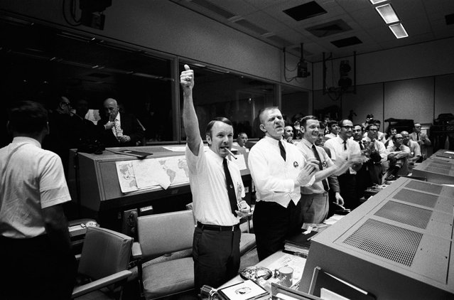 Three of the four Apollo 13 Flight Directors applaud the successful splashdown of the Command Module 'Odyssey' while Dr. Robert R. Gilruth, Director, Manned Spacecraft Center (MSC), and Dr. Christopher C. Kraft Jr., MSC Deputy Director, light up cigars (upper left). The Flight Directors are from left to right: Gerald D. Griffin, Eugene F. Kranz and Glynn S. Lunney on April 17, 1970 (Photo by NASA/ullstein bild via Getty Images)