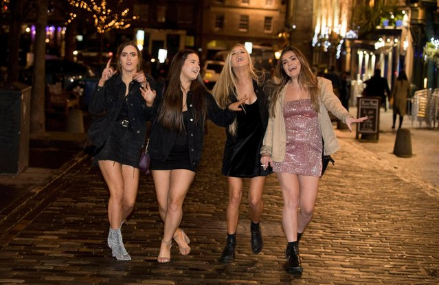 These women hit the streets of the Scottish Capital Edinburgh on December 31, 2017 to celebrate Hogmanay. (Photo by SWNS:South West News Service)