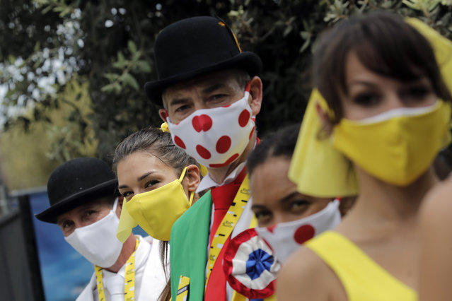 Tour de France hostess wear face masks prior to the start of the first stage of the Tour de France cycling race over 156 kilometers (97 miles) with start and finish in Nice, southern France, Saturday, August 29, 2020. (Photo by Christophe Ena/AP Photo)