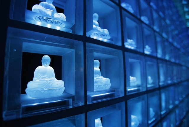 "Buddha statues carved in crystals are pictured at the ""Ruriden"", a cemetery that uses high-powered LED lights to illuminate over 2,000 Buddha statues, in downtown Tokyo October 27, 2014. (Photo by Toru Hanai/Reuters)"