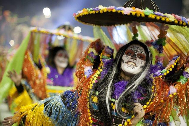 Members of the samba school Rosas de Ouro Special Group participate in a carnival parade at the sambodromo of Anhembi in Sao Paulo, Brazil, 08 February 2013. (Photo by Sebastiao Moreira/EPA)