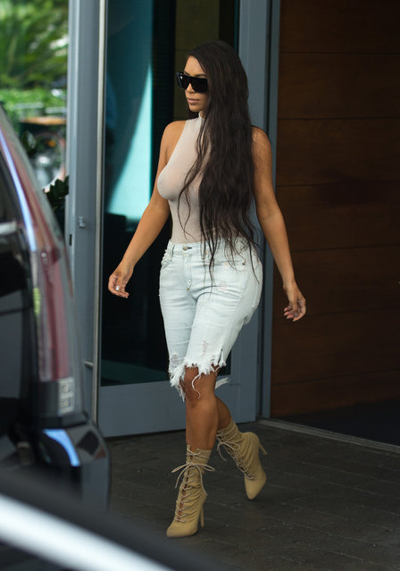 Kim Kardashian heads out in Miami wearing a see-through nude color top on September 17, 2016. (Photo by Splash News and Pictures)