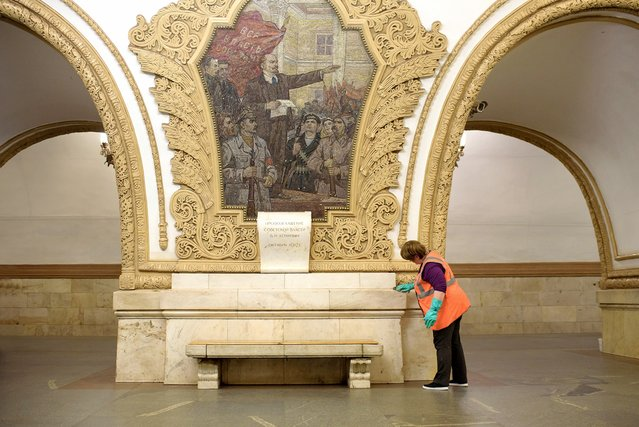 At the Kievskaya station, the marble is polished three times a day by cleaning crews. The station was opened in 1954. (Photo by Didier Bizet/The Washington Post)