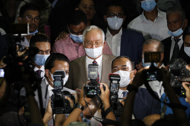 Former Malaysian Prime Minister Najib Razak, leaves the court house in Kuala Lumpur, Malaysia, Tuesday, July 28, 2020. The court has sentenced Najib to serve 12 years in prison after finding him guilty in the first of several corruption trials linked to the multibillion-dollar looting of a state investment fund that brought down his government two years ago. (Photo by Vincent Thian/AP Photo)