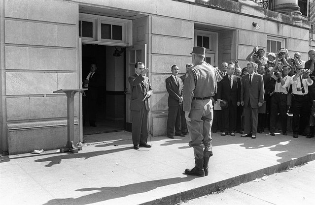 Alabama's governor George Wallace (left) faces General Henry Graham, in Tuscaloosa, at the University of Alabama, on June 12, 1963. Wallace blocked the enrollment of two African-American students, Vivian Malone and James Hood. (Photo by OFF/AFP Photo)