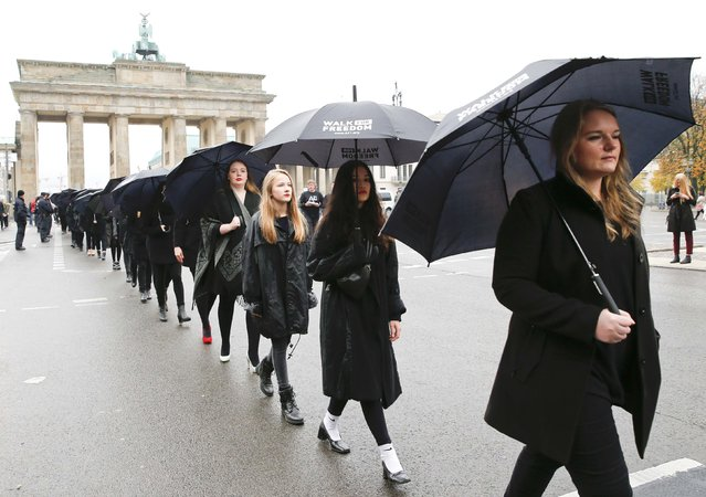 Activists take part in a 'Walk for Freedom' to protest against human trafficking, in front of the Brandenburg Gate in Berlin, Germany, October 17, 2015. (Photo by Fabrizio Bensch/Reuters)
