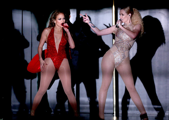 Jennifer Lopez, left, and Iggy Azalea perform at the 42nd annual American Music Awards at Nokia Theatre L.A. Live on Sunday, November 23, 2014, in Los Angeles. (Photo by Matt Sayles/Invision/AP Photo)