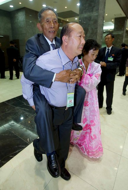 South Korea Jung Woo-il (C) carries his North Korean uncle Shin Kyung Mook on his back during the separated family reunions at Mount Kumgang resort, North Korea, October 21, 2015. (Photo by Reuters/Yonhap)
