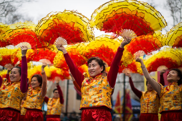 Dancers perform during a cultural festival to mark the first day of the Lunar New Year in Chinatown neighborhood in Manhattan, February 16, 2018 in New York City. The 2018 Chinese New Year, which is the year of the dog, begins on Friday and celebrations will last for over two weeks. (Photo by Drew Angerer/Getty Images)