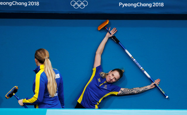 Agnes Knochenhauer and Sofia Mabergs of Sweden stretch before a practice session at the 2018 Winter Olympics in Gangneung, South Korea on February 20, 2018. (Photo by Cathal McNaughton/Reuters)