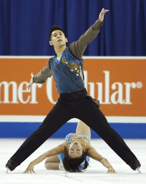 Sui Wenjing and Han Cong of China perform during the pairs free skate program at the Skate America figure skating competition in Milwaukee, Wisconsin October 24, 2015. (Photo by Lucy Nicholson/Reuters)