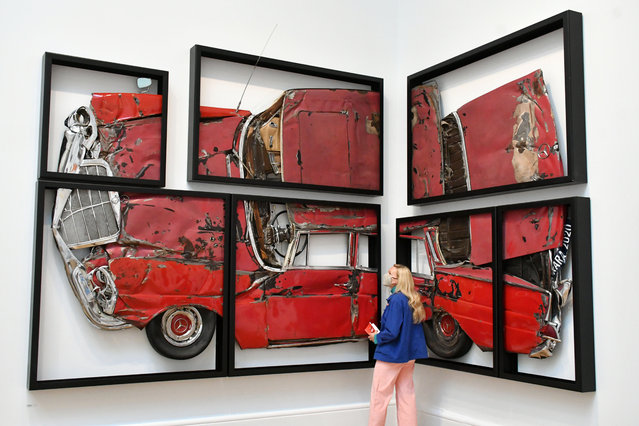 """A visitor looks at Ron Arad's artwork called """"Oh Lord, Won't You Buy Me?"""", at the Royal Academy of Arts summer exhibition in London, England on September 28, 2020. (Photo by Nils Jorgensen/Rex Features/Shutterstock)"""