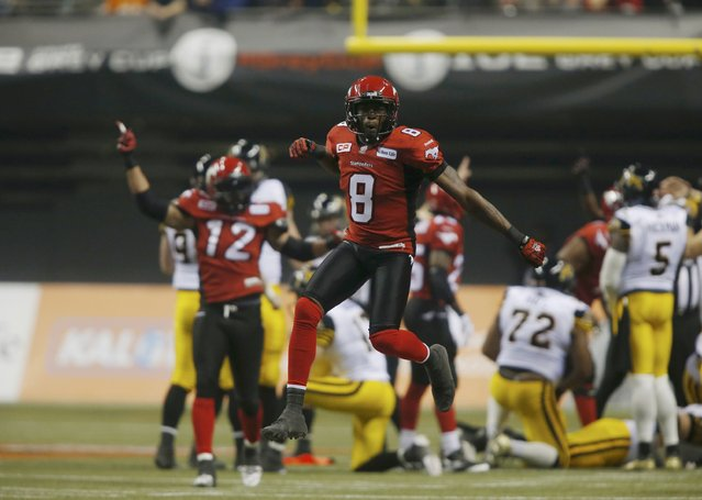 Calgary Stampeders' Fred Bennett celebrates after the Stampeders blocked a field goal attempt by the Hamilton Tiger Cats in the first half during the CFL's 102nd Grey Cup football championship in Vancouver, British Columbia, November 30, 2014. (Photo by Ben Nelms/Reuters)