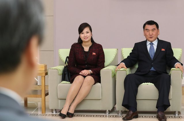 Hyon Song-wol (C), leader of North Korea's Moranbong Band and Park Chun-nam (R) talk with South Korean Culture, Sports and Tourism Minister Do Jong-whan (L) after minister Do Jong-whan arrived at the Pyongyang International Airport in Pyongyang, North Korea, 31 March 2018 (issued 01 April 2018). A 120-member troupe of South Korean performers will stage two performances in North Korea on 01 April and 03 April 2018, the first such event since 2005. (Photo by EPA/EFE/Stringer)