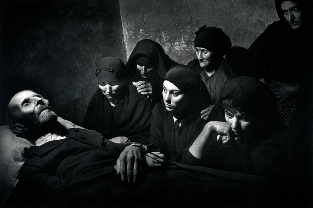 His wife, daughter, granddaughter and friends have their last earthly visit with a villager. (Photo by W. Eugene Smith/Time & Life Pictures)