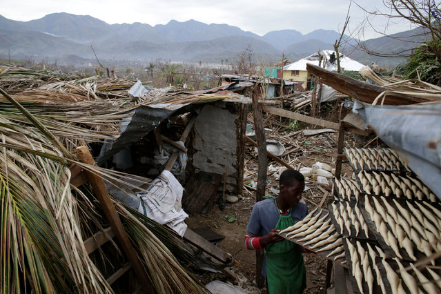 A boy works at a bakery after Hurricane Matthew in Les Anglais, Haiti, October 14, 2016. (Photo by Andres Martinez Casares/Reuters)