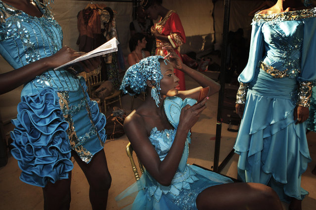 Senegalese models wait backstage during Dakar Fashion Week in Senegal's capital, July 10, 2011. (Photo by Finbarr O'Reilly/Reuters)