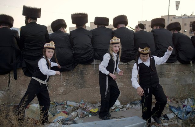 Ultra-Orthodox Jews of the Belz Hasidic Dynasty attend the wedding ceremony of Rabbi Shalom Rokach, the Grandson of the Belz Rabbi to Hana Batya Pener, in Jerusalem on May 21, 2013. Some 25,000 Ultra-Orthodox Jews participated in one of the biggest weddings in the past few years. (Photo by Menahem Kahana/AFP Photo)