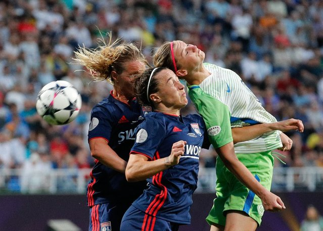 Alexandra Popp (R) of Wolfsburg in action against Lucy Bronze (C) of Lyon during the UEFA Women's Champions League final between Wolfsburg and Lyon in Kiev, Ukraine, 24 May 2018. (Photo by Sergey Dolzhenko/EPA/EFE/Rex Features/Shutterstock)